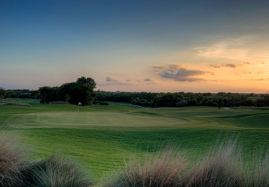 The sun sets over the course at The Golf Club at Star Ranch in Hutto, Texas